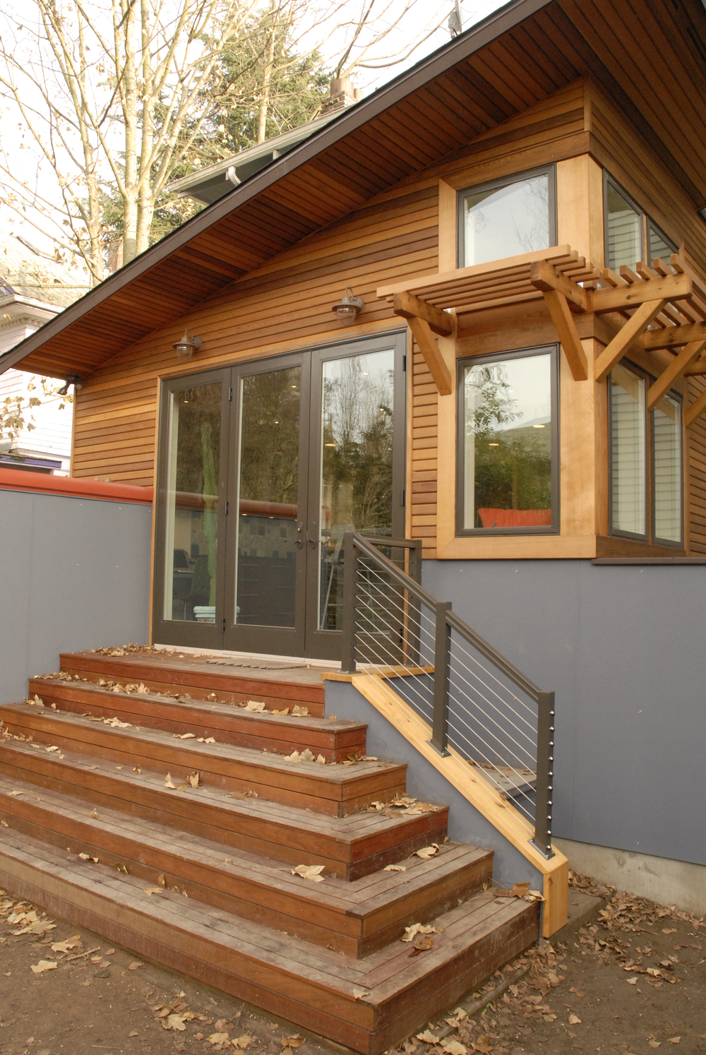 Exterior is dramatic in style using eco-friendly cedar and natural finish