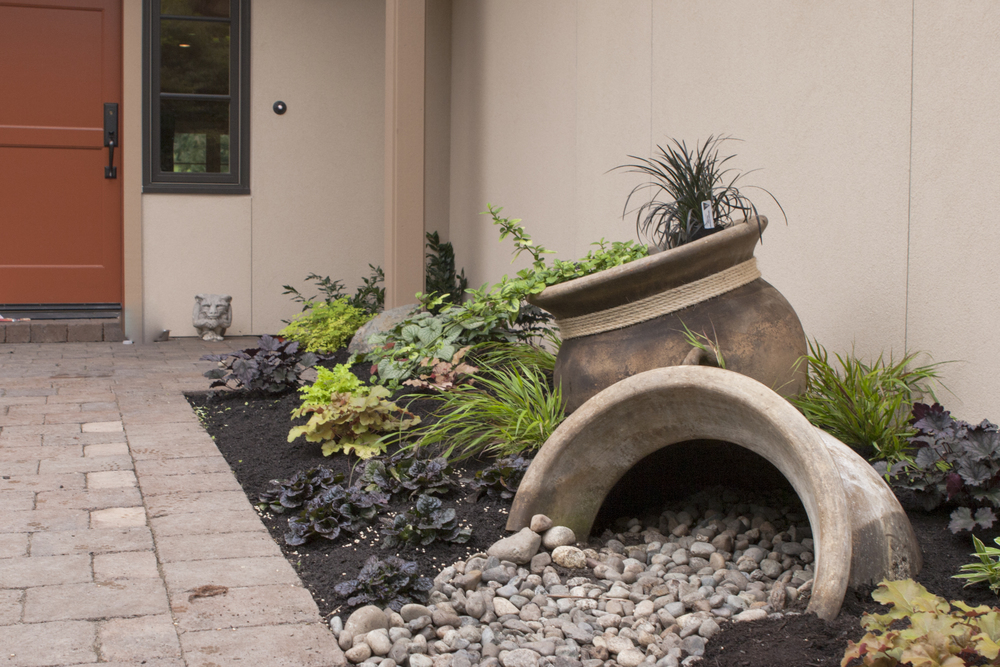 The client a passionate and talented gardener designed and installed most of the landscaping.