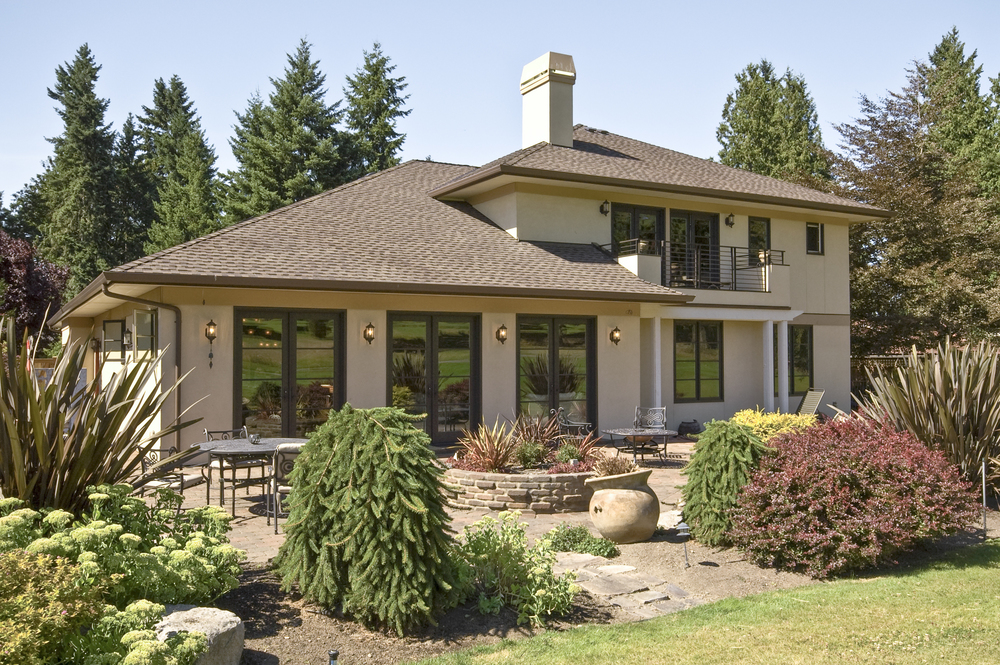 The home is just as beautiful from the back situated on a golf course.