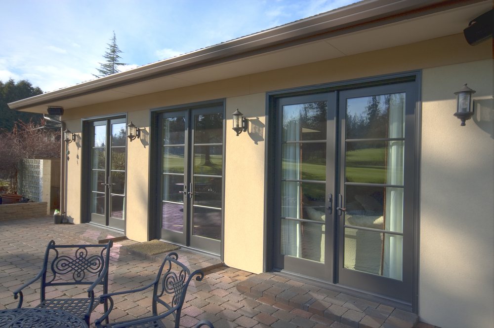 The design maximizes the daylight and the view through the three sets of 8' French doors.