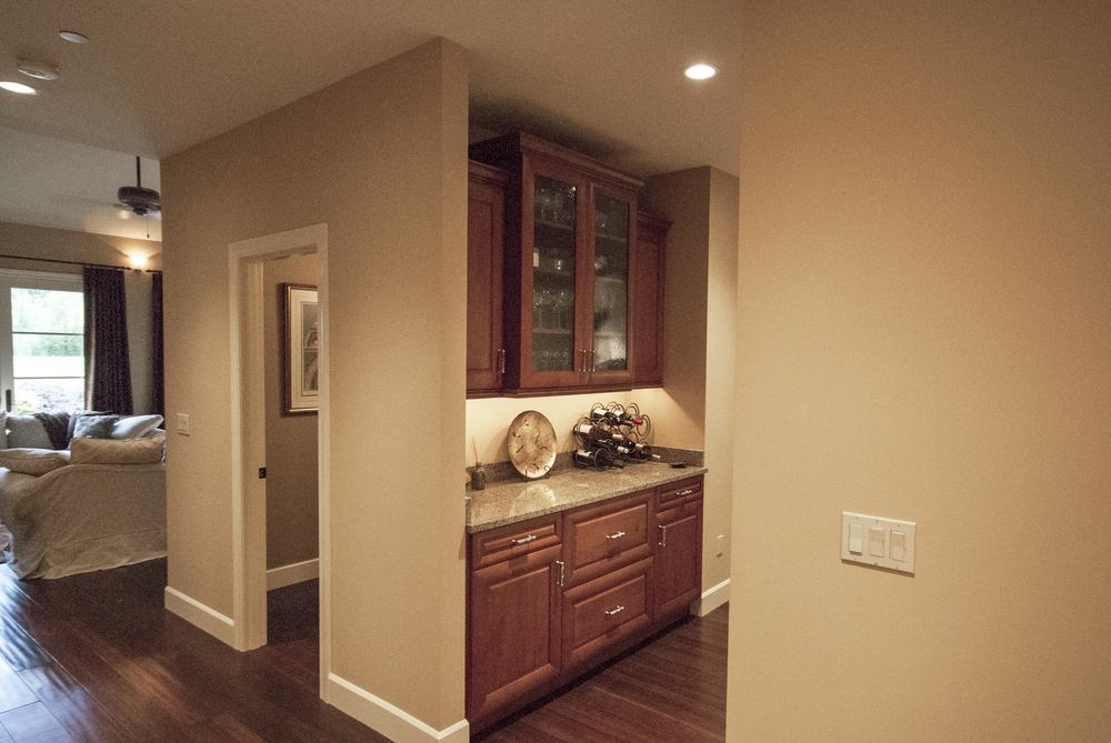 A custom butlers pantry for storing and serving liquor is also a favorite hang-out as guests wait for their drinks.