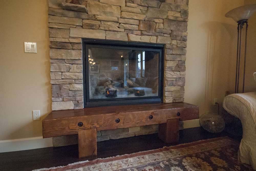 The fireplace hearth was built of recycled timber by project developer Matt Hesselgrave and is one of the clients favorite parts of the project.