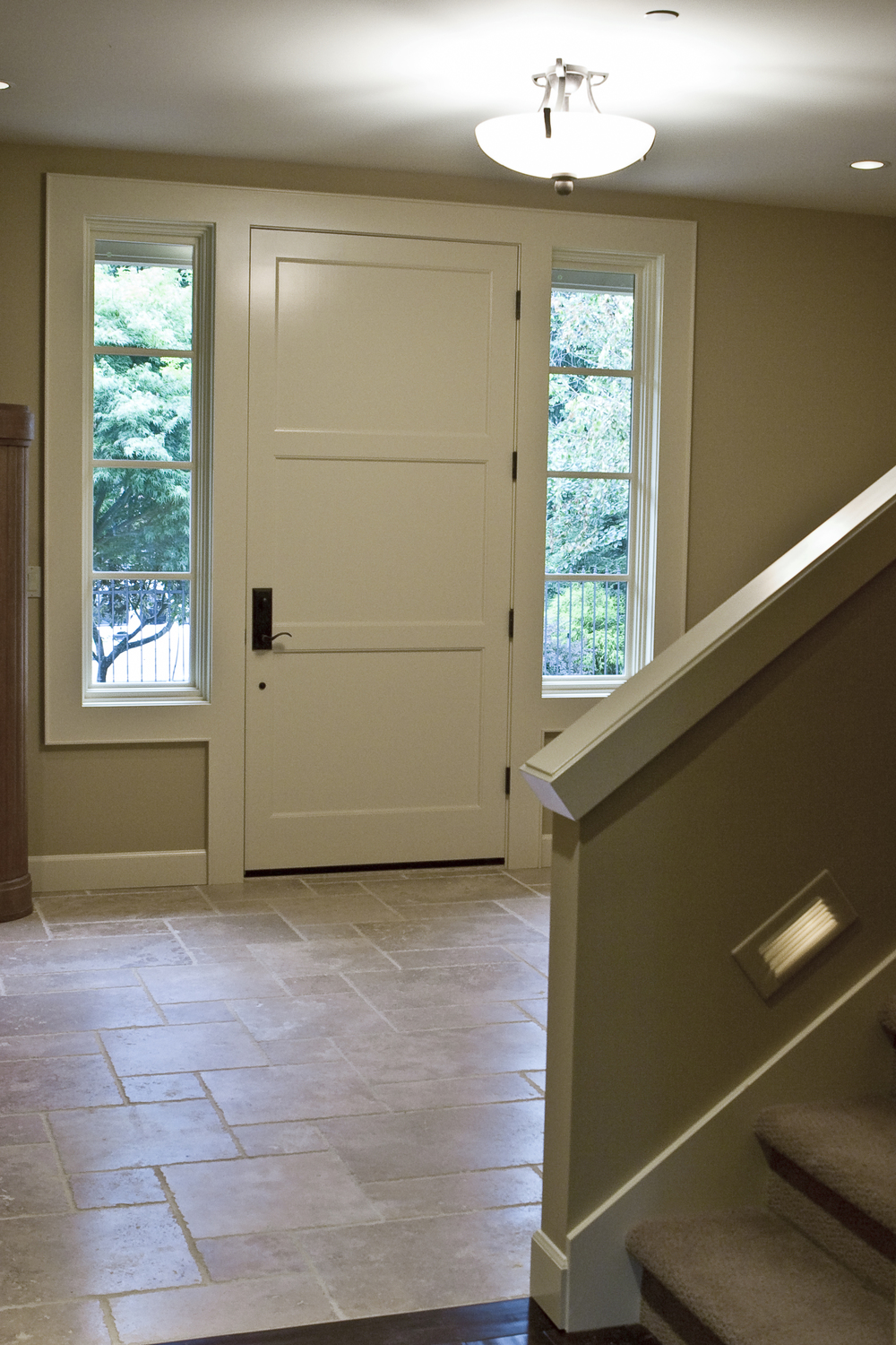 """Front entry and landing - the """"foot"""" lights on the stairs were a must."""