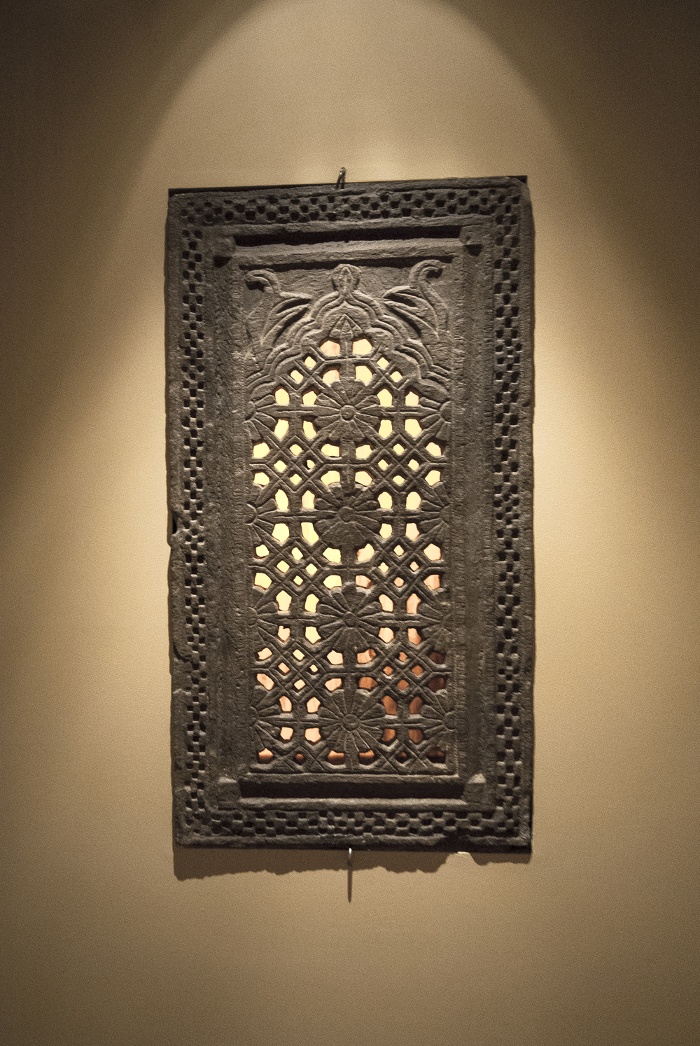 "The ""temple window nook"" houses an 800 year old window from a Hindu temple.  The window is recessed into the wall and back lit by a Lexan plastic panel."