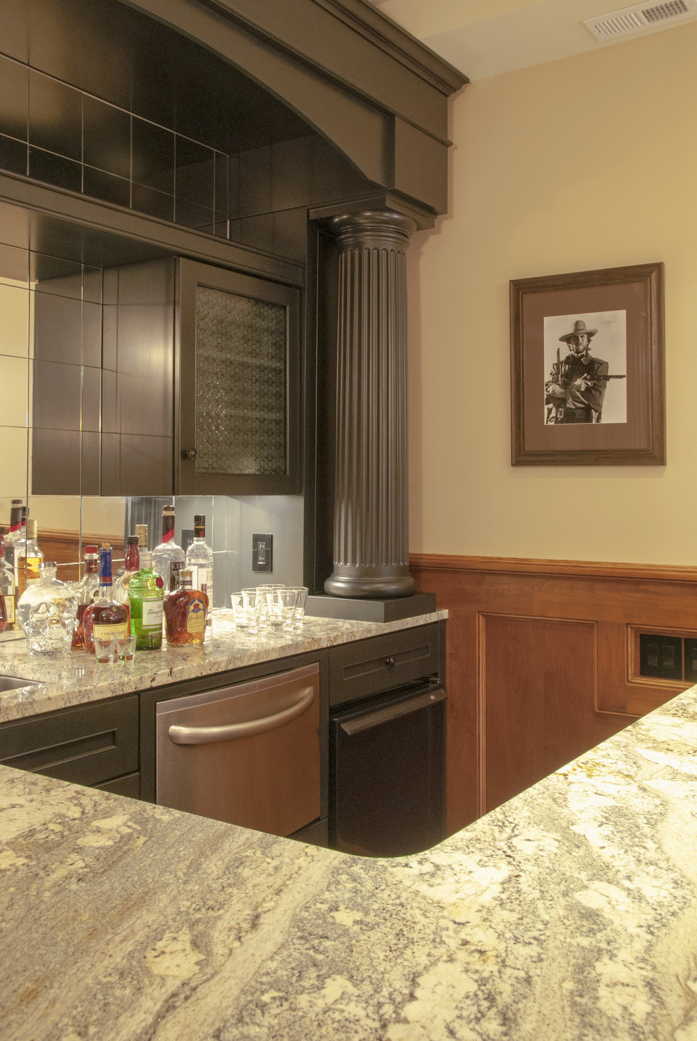 The bar also features a drawer dishwasher and beverage fridge.