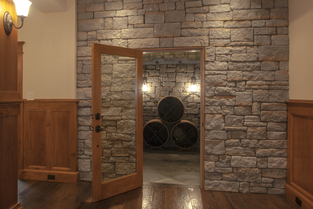 This wine cellar is one of a kind!  It features stacked field stone walls and a custom ceiling mural of the Tuscan countryside.