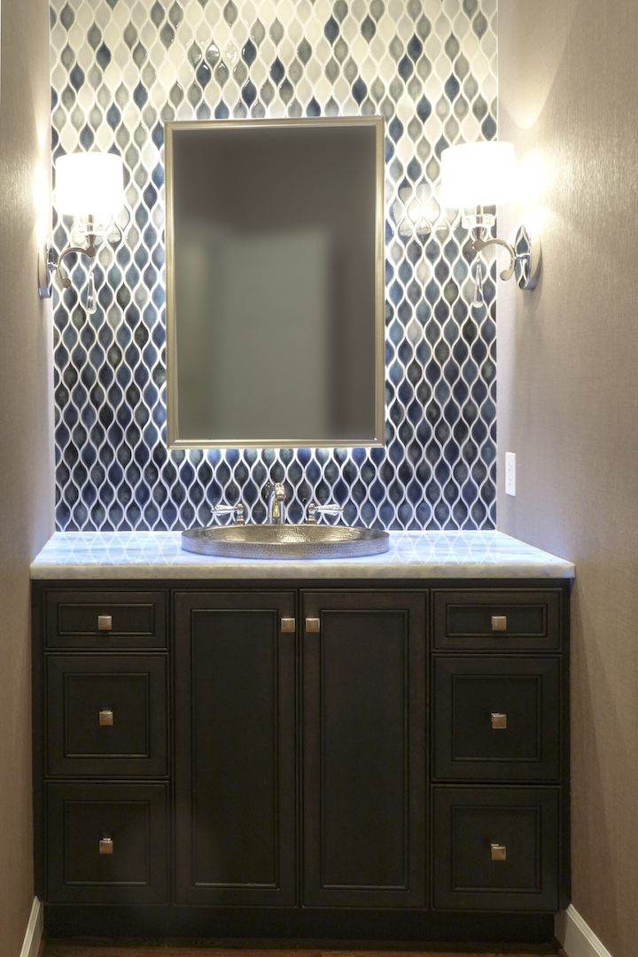 A beautiful Powder bath with exquisite details like handmade tiles, which fade from light to dark...