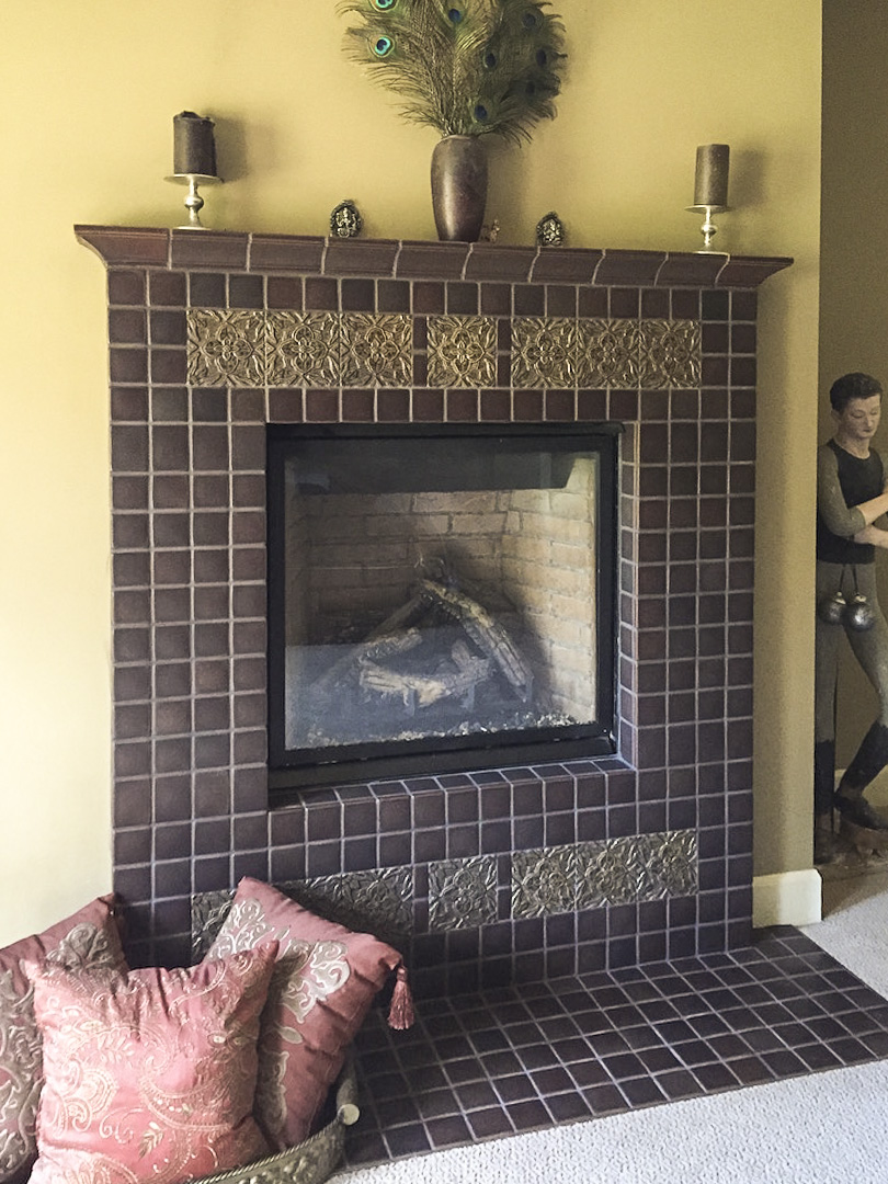 This handmade custom tile fireplace surround became the focal point of an already beautiful  Master Suite.