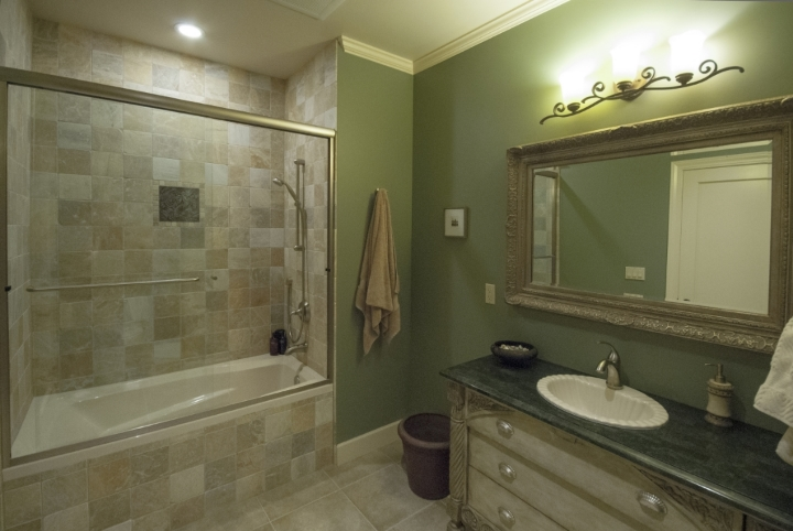 The shower wall and floor tile was inexpensive ceramic.