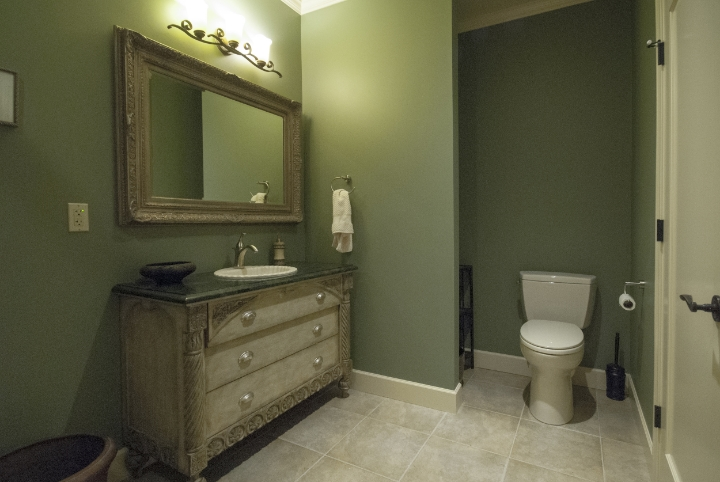"The ""green bath"" was our budget bath but you'd never guess it.  The sink base, an old dresser, was refinished by the client."