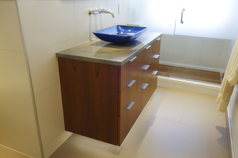 master bath with floating cabinet