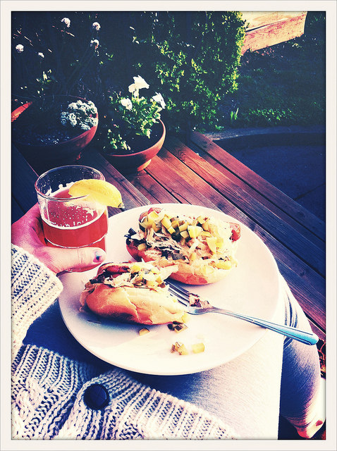 tonight's dinner: veggie dogs and hefeweizen on the sunny, yet chilly, front porch. finally.   -a