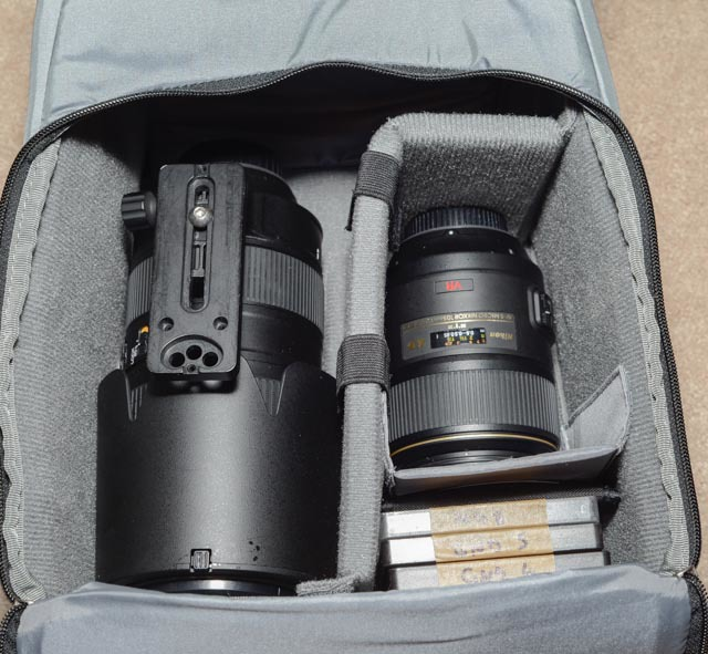 "Although I'd never carry all my lenses on a hike, I loaded them all up just to say ""I can""... this is the padded insert for the main compartment with a Nikon 80-400mm lens (left) and Nikon 105mm macro (right). I also have a handful of filters in there."
