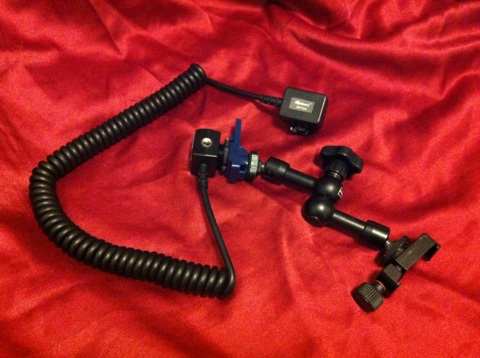 The arm assembly with TTL flash cable attached. From right to left are the mini clamp, flexible magic arm, hot shoe connector and TTL cable.