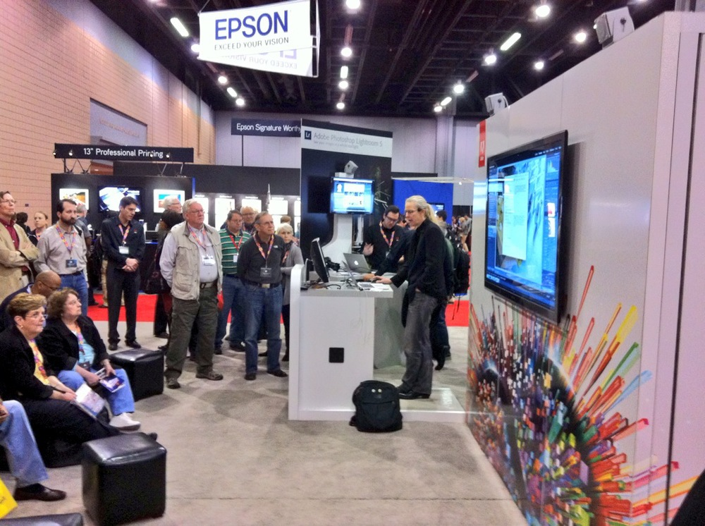 Julieann Kost delivering a sermon on Photoshop at the Adobe booth. She always draws a big crowd!