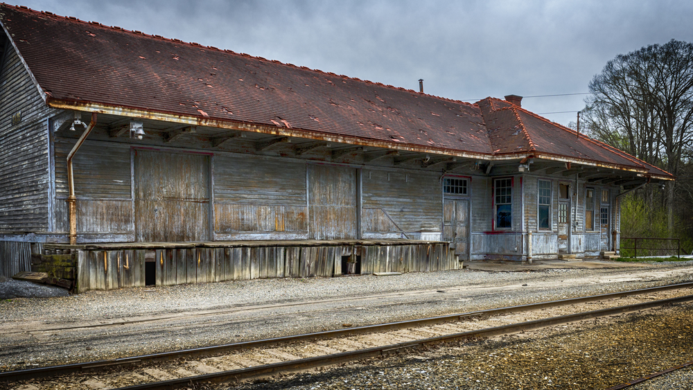 An old dilapidated train depot and station in north Georgia. While the station and depot are no longer in service, the railroad here is still live.