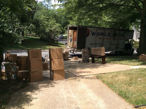 Movers staged all of the boxes, weighing over 7,000lbs, outside before loading them into the crates. It took almost 2 trucks to carry all of those boxes away!