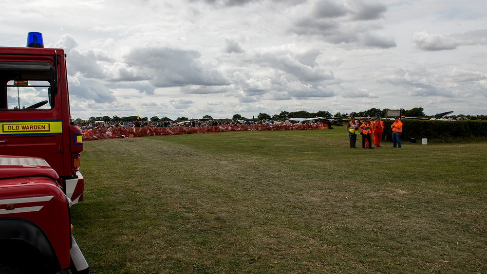 A view of the crowd from my vantage point. Straight ahead is where the planes would park before it was time to perform and the runway is immediately to the right (off image).