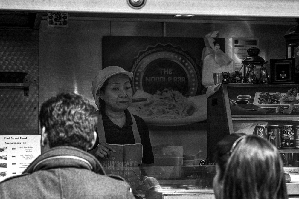 This woman's Thai food truck always smells delicious, but there's normally a long line so I haven't stopped to taste it (yet). The woman in the foreground was just placing her order.