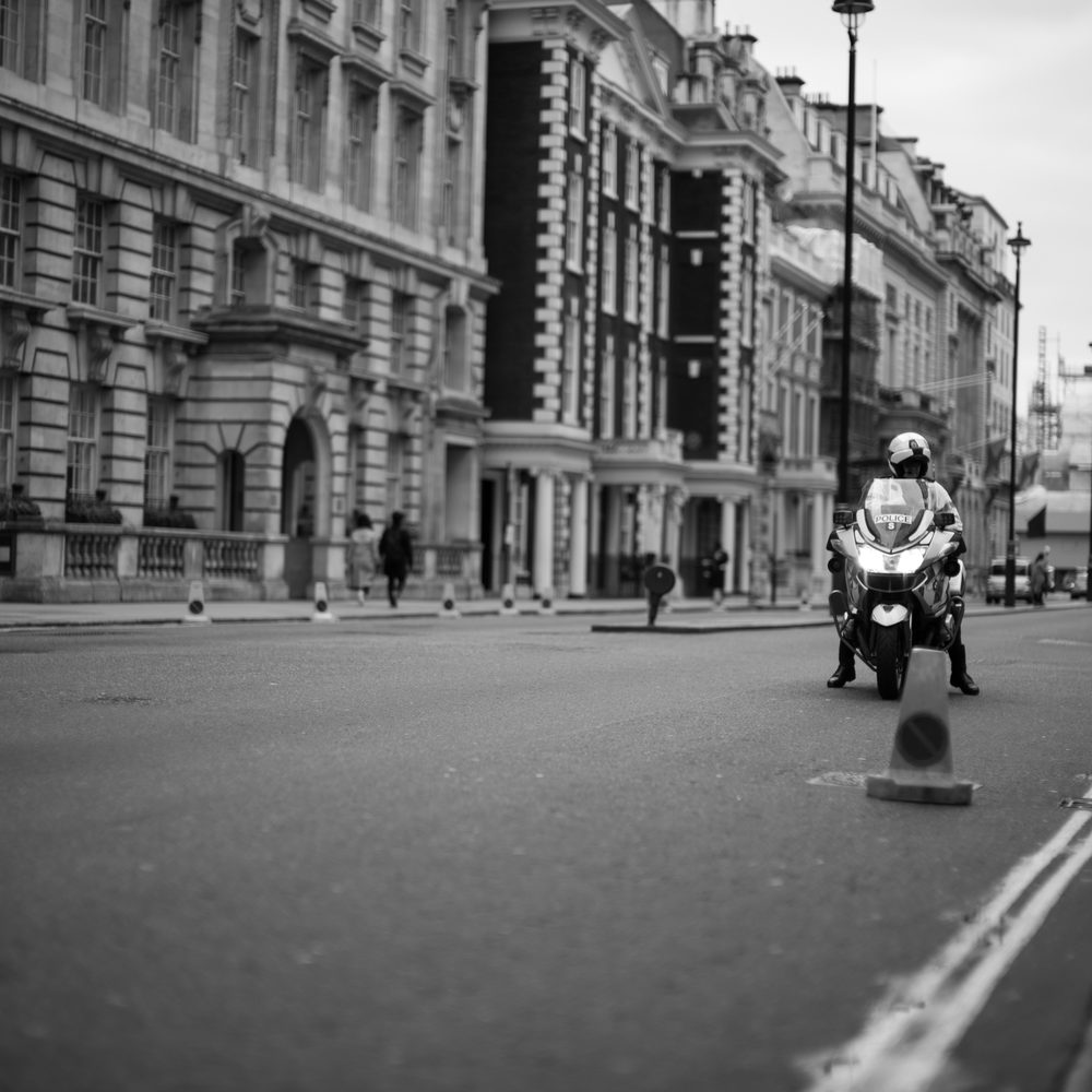 A London traffic police officer closes the road to Trafalgar Square awaiting protestors