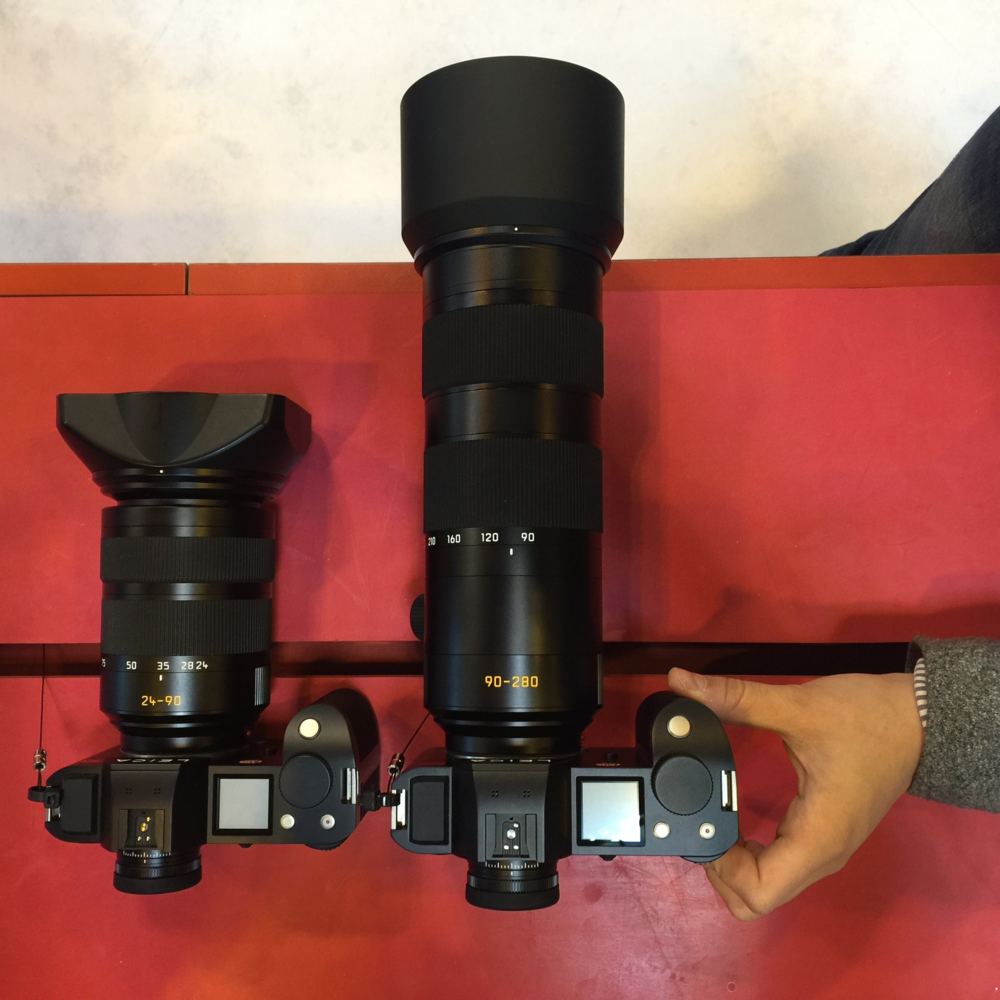 Size comparison between the 24-90mm and 90-280mm lenses.