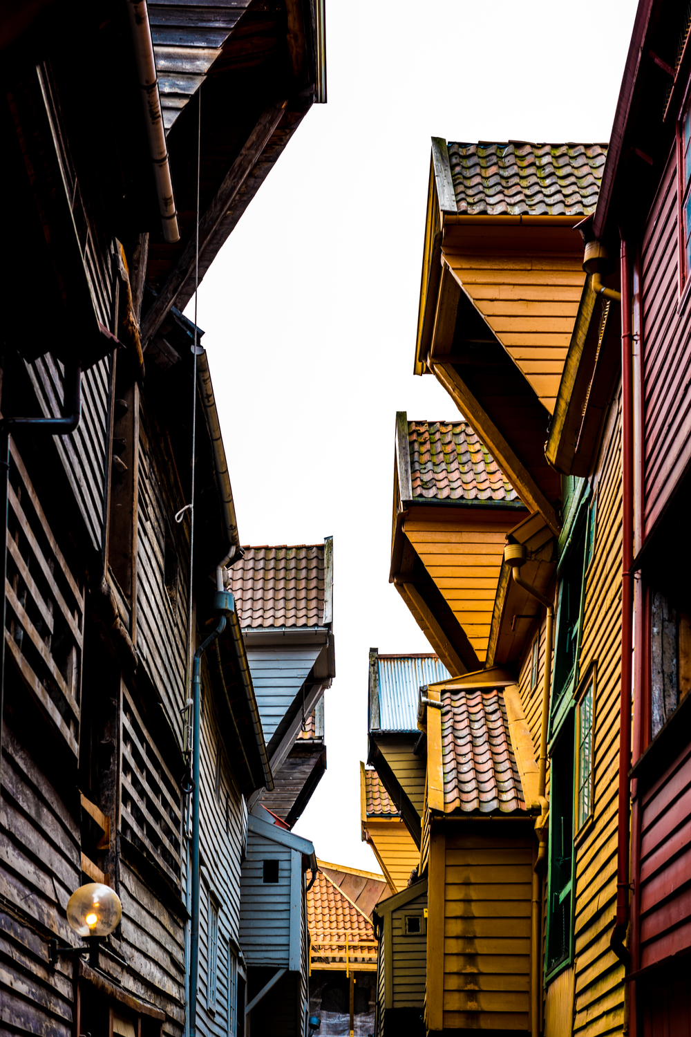 Wooden shops and homes lining the streets of Bergen, Norway
