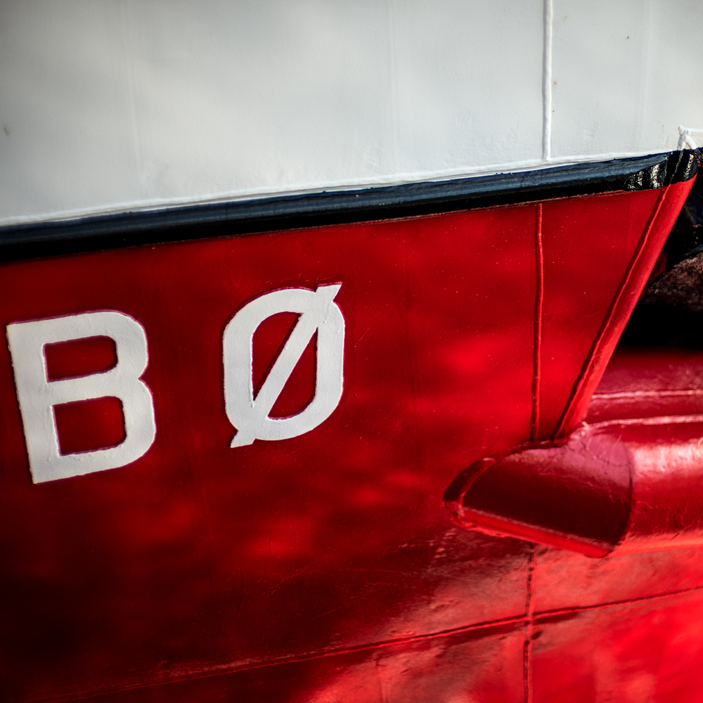 """BO"" - part of the bow of a large commercial fishing vessel docked in Alesund."