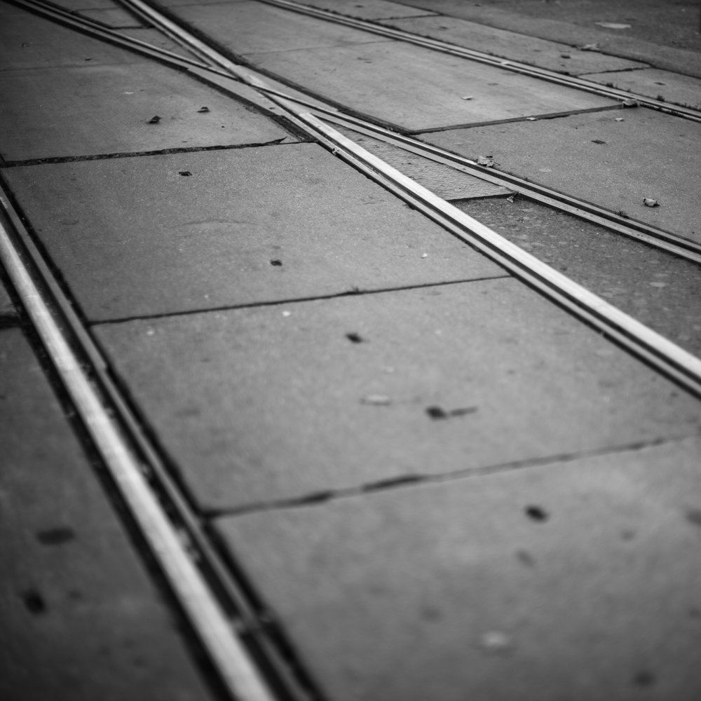 Tram tracks in a busy intersection in Vienna, Austria