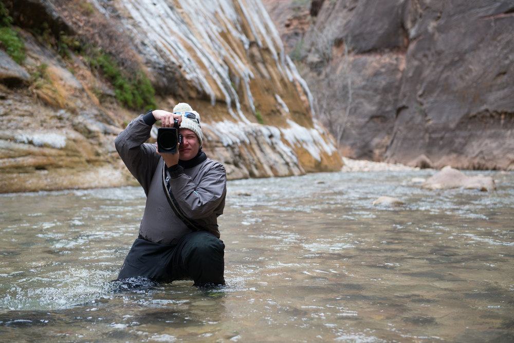 Look ma! No strap as I carry the camera through the famous Virgin River hike in the Narrows. Also, this drysuit isn't the least bit flattering. Photo by Seth Hamel, http://www.zion-photography.com.