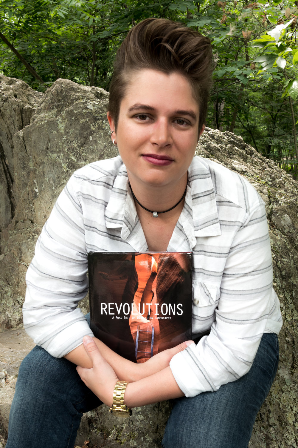 Posing with the final copy of my book, Revolutions.