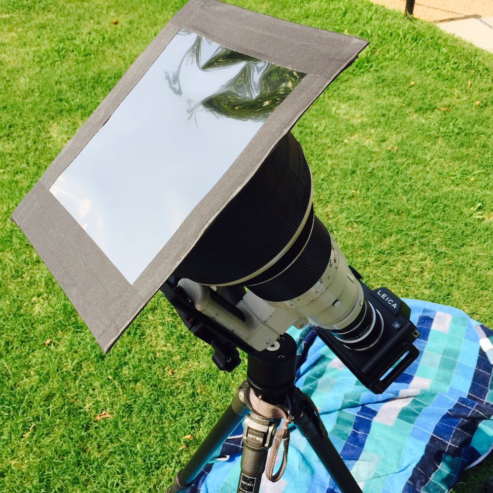 The homemade solar filter mounted to the front of my lens