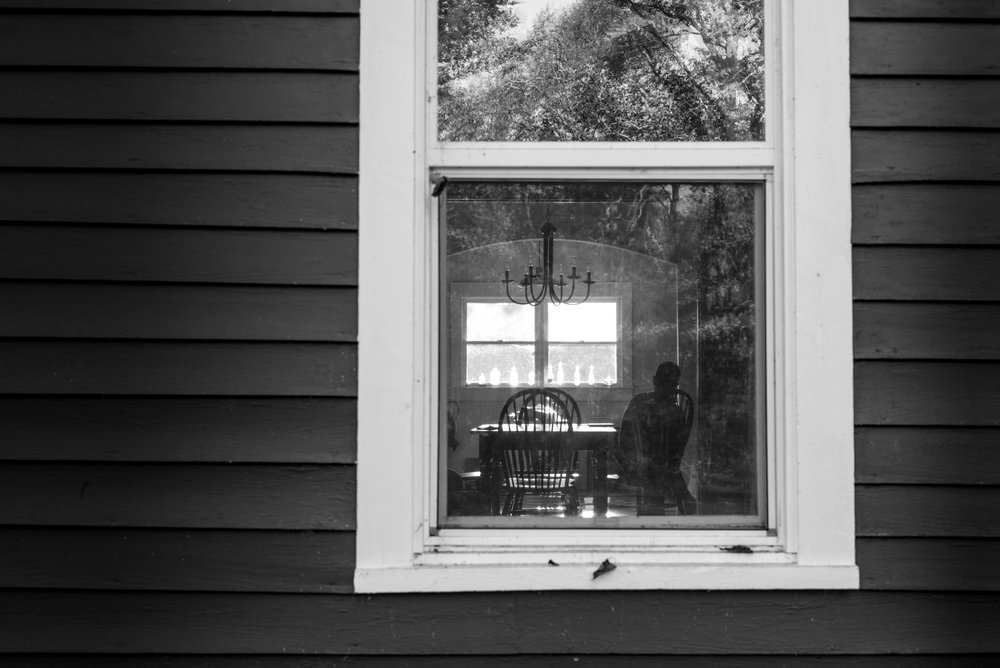 Playing with reflections and silhouettes in the window. That's actually my mom sitting at the kitchen table.