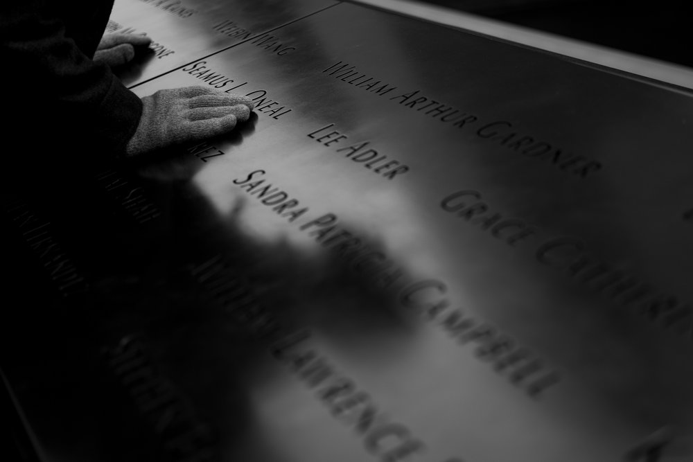 A visitor to the memorial paying tribute to some of the victims from 9/11.