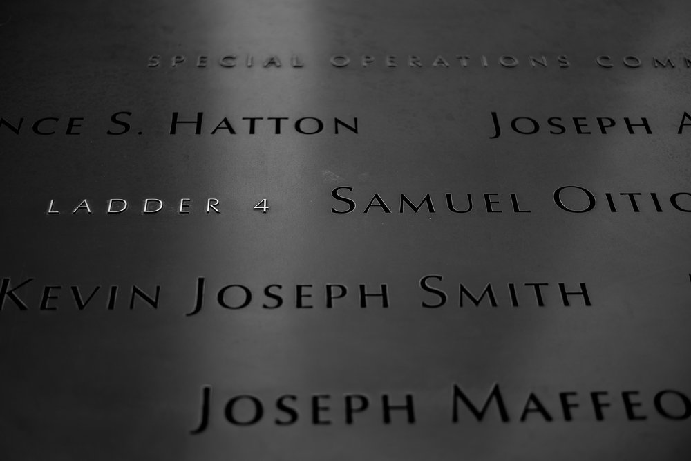 Names and organizations listed on the memorial wall surrounding the pools in the memorial.