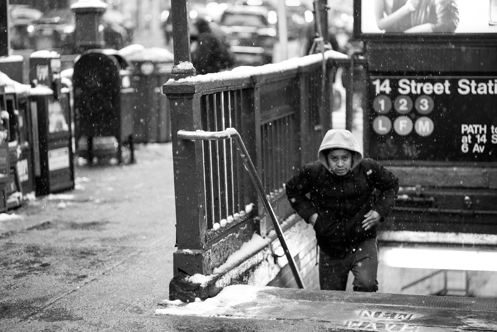 A man emerges from the 14th street subway station