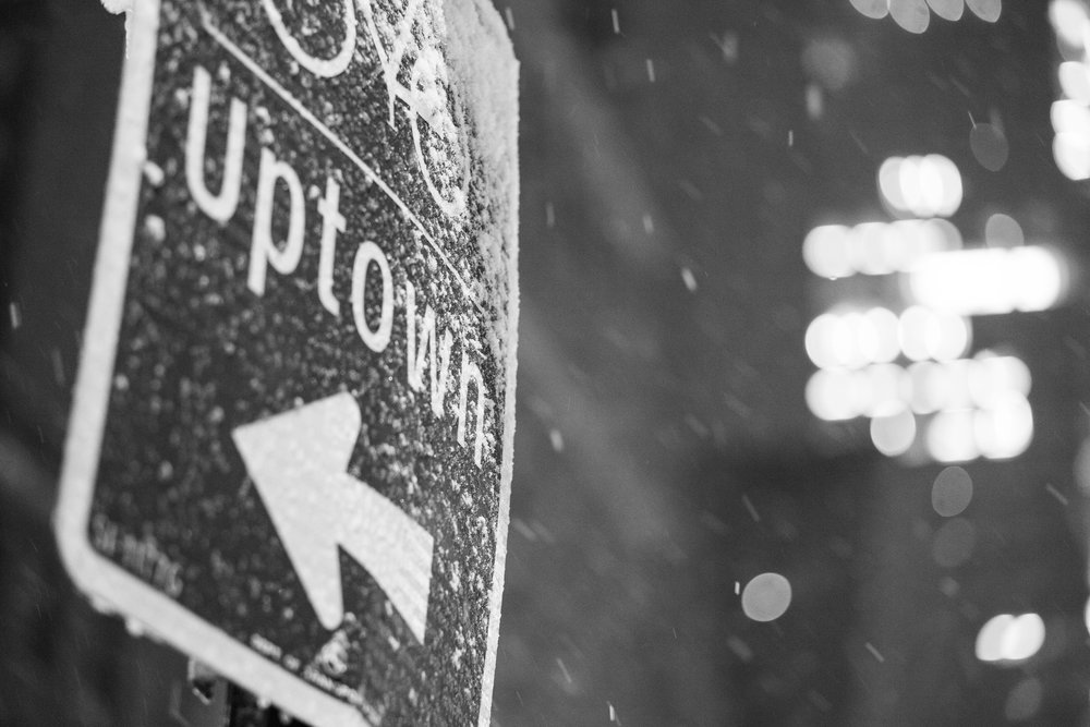 A streetsign covered with snow outside Times Square