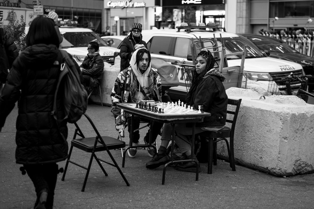 Waiting for an opponent. Two people playing chess outside a park in Manhattan island. Leica M10 with 90mm Summicron f/2.