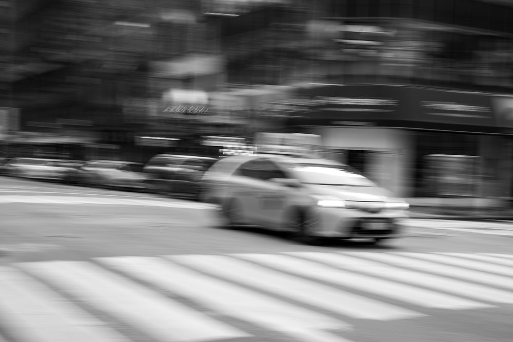 The Commute.  I purposefully blurred this image by jerking the camera in a violent pan as the taxi approached. The goal was to create a shot that captured the blur of commuting and traffic in a city as busy as New York.  Leica M10 with 90mm Summicron f/2.