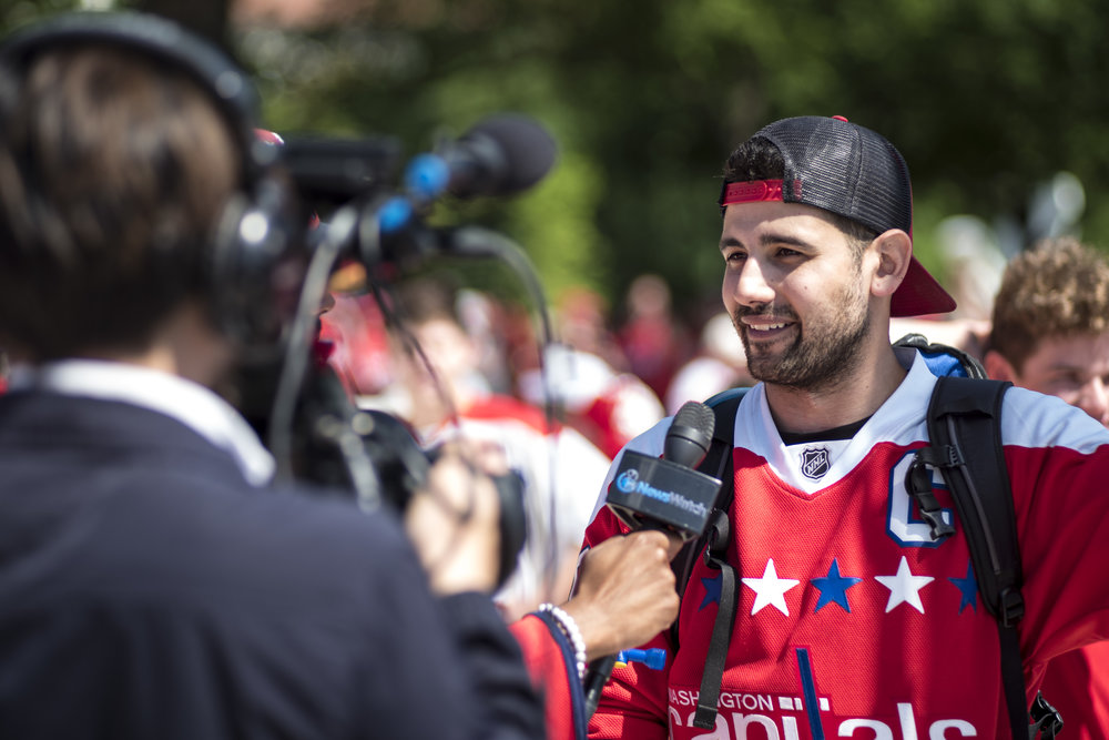 A fan does an interview for a local TV station