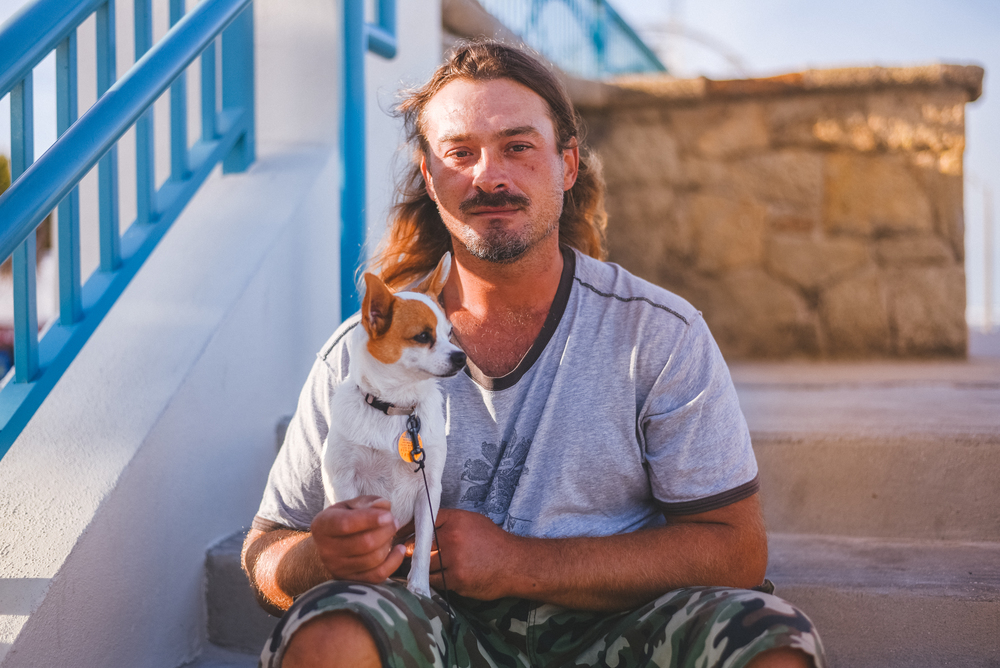 Man holding dog.jpg
