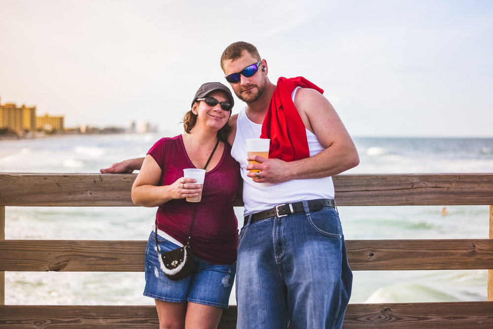 couple holding beers.jpg