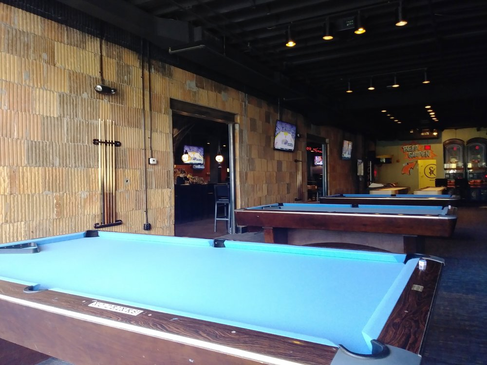 Gameroom     With three 9ft pool tables, two shuffleboard tables, pop-a-shot basketball, Big Buck Hunter Pro, Golden Tee and seven HDTVs, this is the room to throw down.