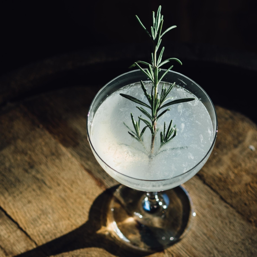 The 10d -  2.5 oz  OOLA Vodka or Gin1 oz  Fresh Lime Juice 1/4 oz  Simple SyrupShaken with ice and served upGarnish with fresh rosemary