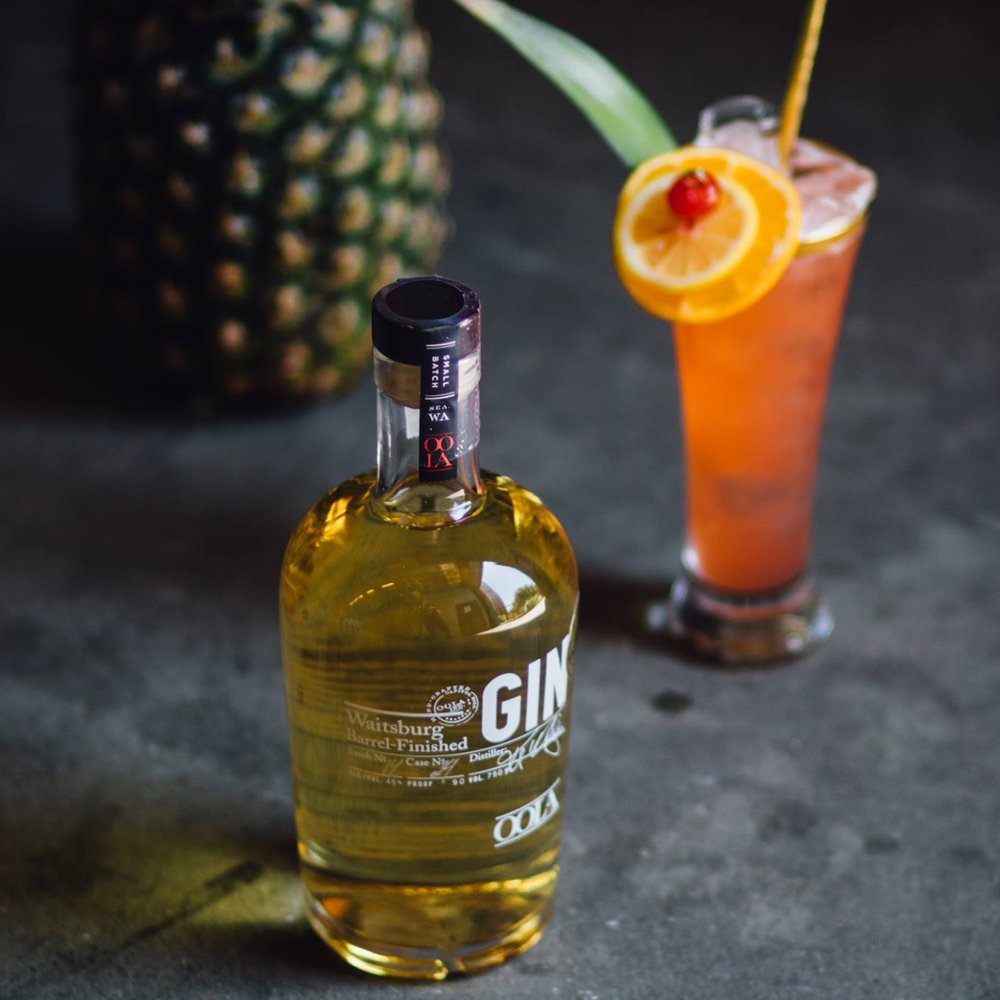 Olympic Junglebird - 1.5 oz  OOLA Waitsburg Barrel-Finished Gin⠀⠀3/4 oz  Campari⠀⠀1.5 oz  Pineapple Juice⠀⠀1/2 oz  Fresh Lime Juice⠀⠀1/2 oz  Simple syrup⠀⠀Shake and Strain into a tall ice-filled glassGarnish with orange slice and cherry