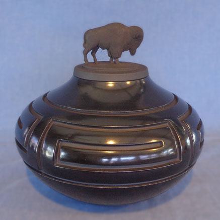 Black Buffalo lidded Jar with Walking Bear Paw Design