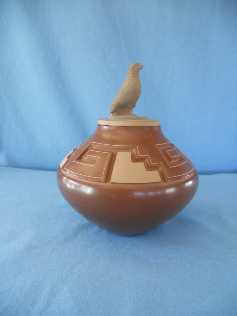 Red Eagle lidded Jar with Walking Bear Paw and Kiva Step designs.
