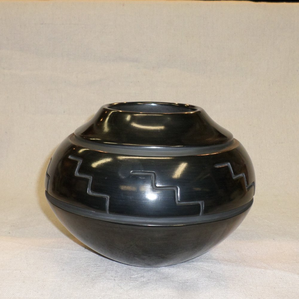 "Black carved traditional Jar with Kiva step Design  6"" H X 8-1./4"" Dia.  SOLD"