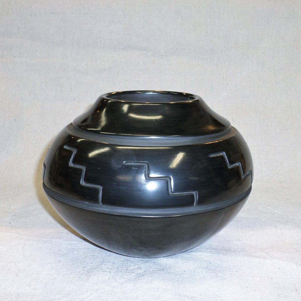 "Black carved traditional Jar with Kiva step Design  6"" H X 8-1./4"" Dia.  $2,400."