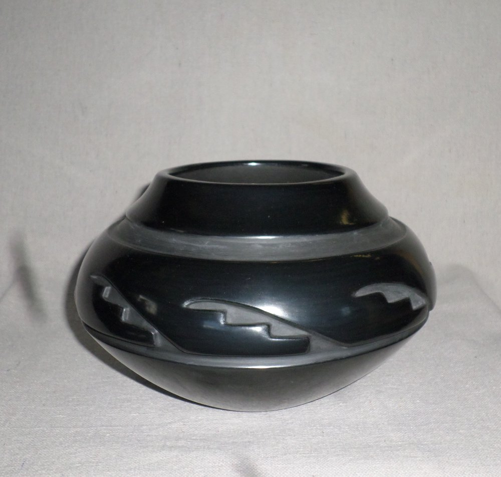 "Black carved Kiva Step Desjgn Jar  5-1/4"" H X 8-3/8"" Dia.  Price $2,200."