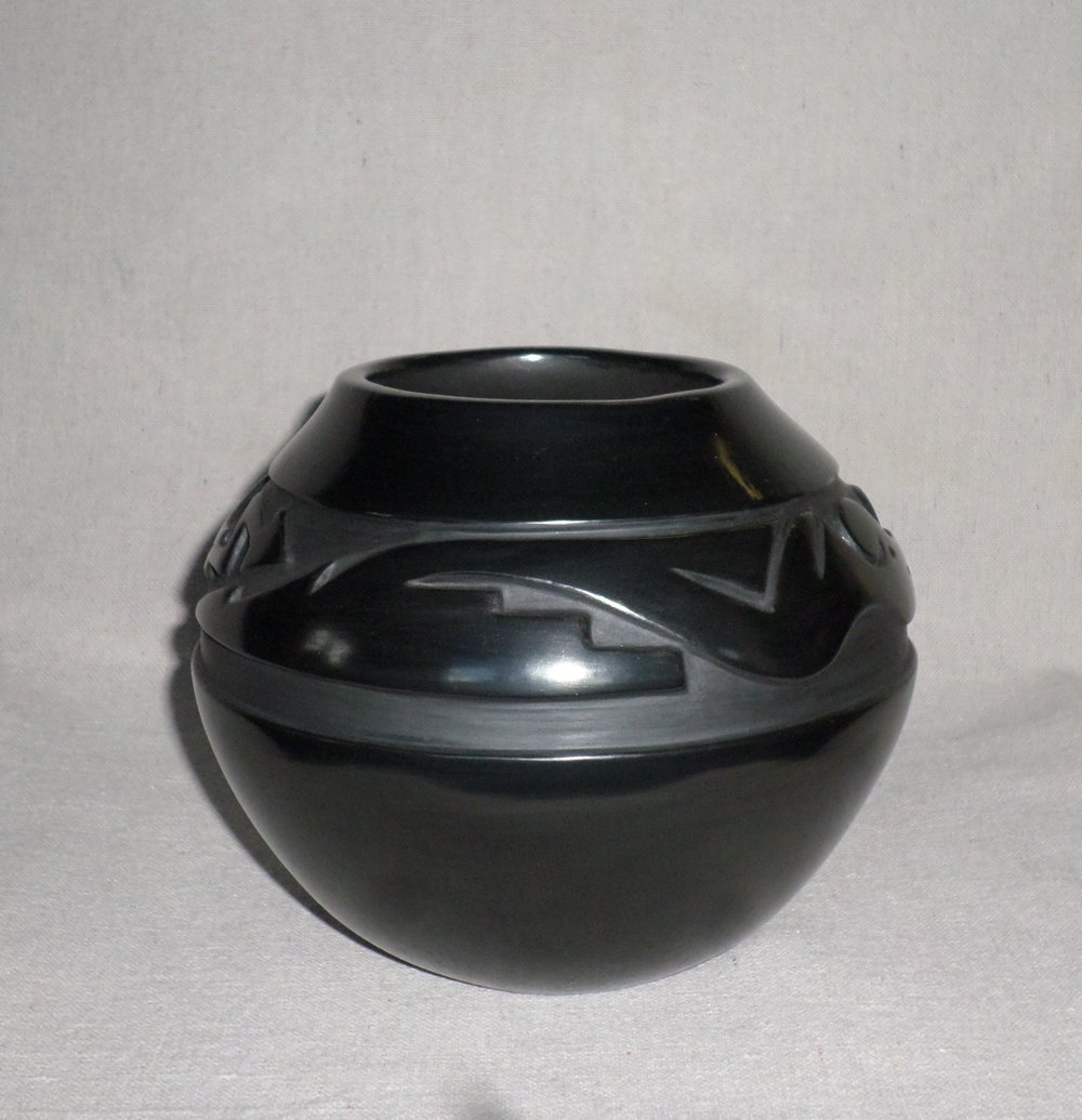 "Black Jar with Two Avanyu Designs   5-7/8"" H X 7-1/8"" Dia.  Price $1,800."